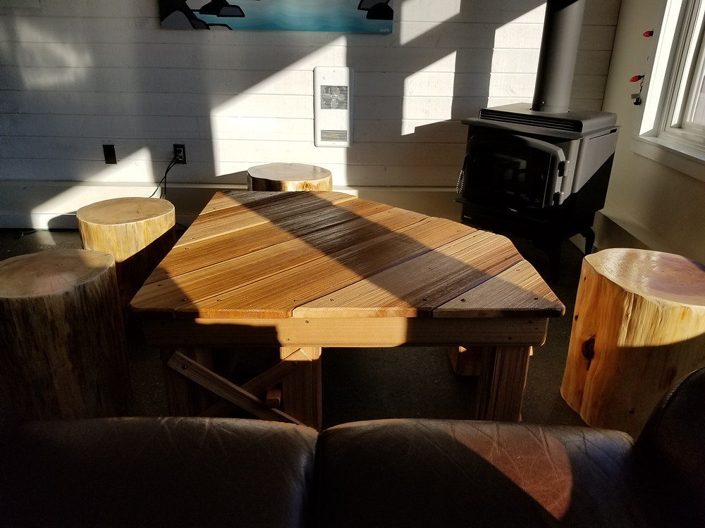 Our friend Illy is a local trail builder and built this amazing piece for us: a mountain biking inspired coffee table. The stools are Hemlock and Cedar that he cut for us and we finished (which took far longer than expected).