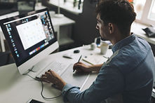 young-graphic-designer-working-office_15
