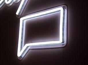 Speech symbol neon light.jpg