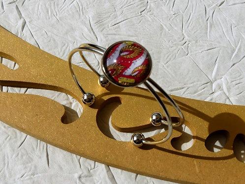 Bracelet rouge doré