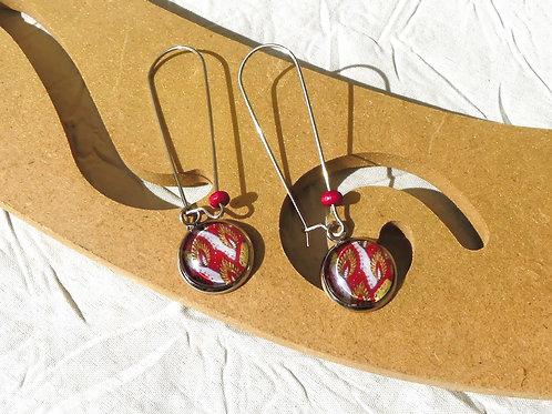 Boucles d'oreille wax