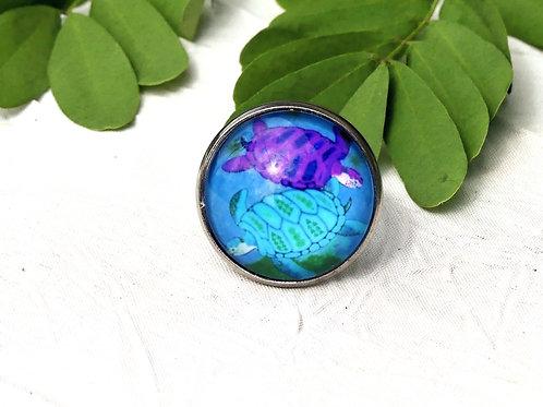 Bague réglable tortues bleus et violets