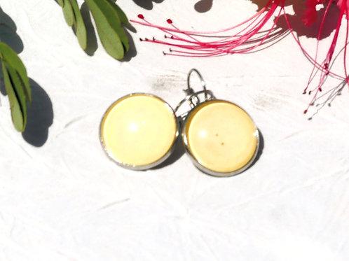 Boucles d'oreille jaunes pales