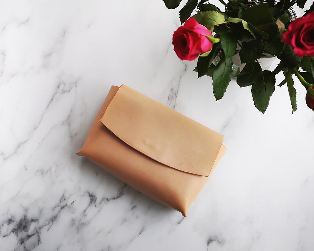 A handmade vegetable tanned leather crossbody bag