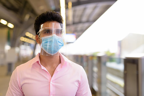 young-indian-businessman-with-mask-and-f