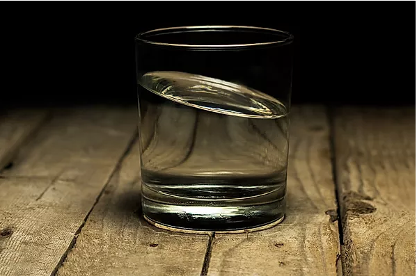 Tilted glass of water
