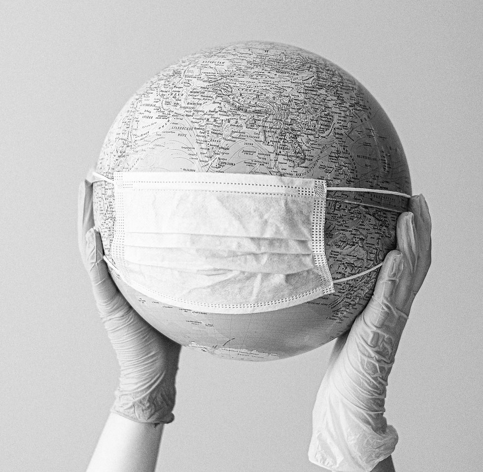 hands-with-latex-gloves-holding-a-globe-with-a-face-mask-4167544_edited.jpg
