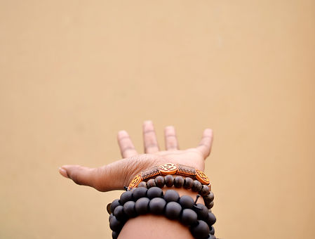 person%20hand%20with%20black%20beaded%20
