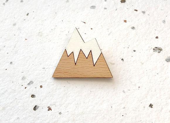 Brož zasněžená hora