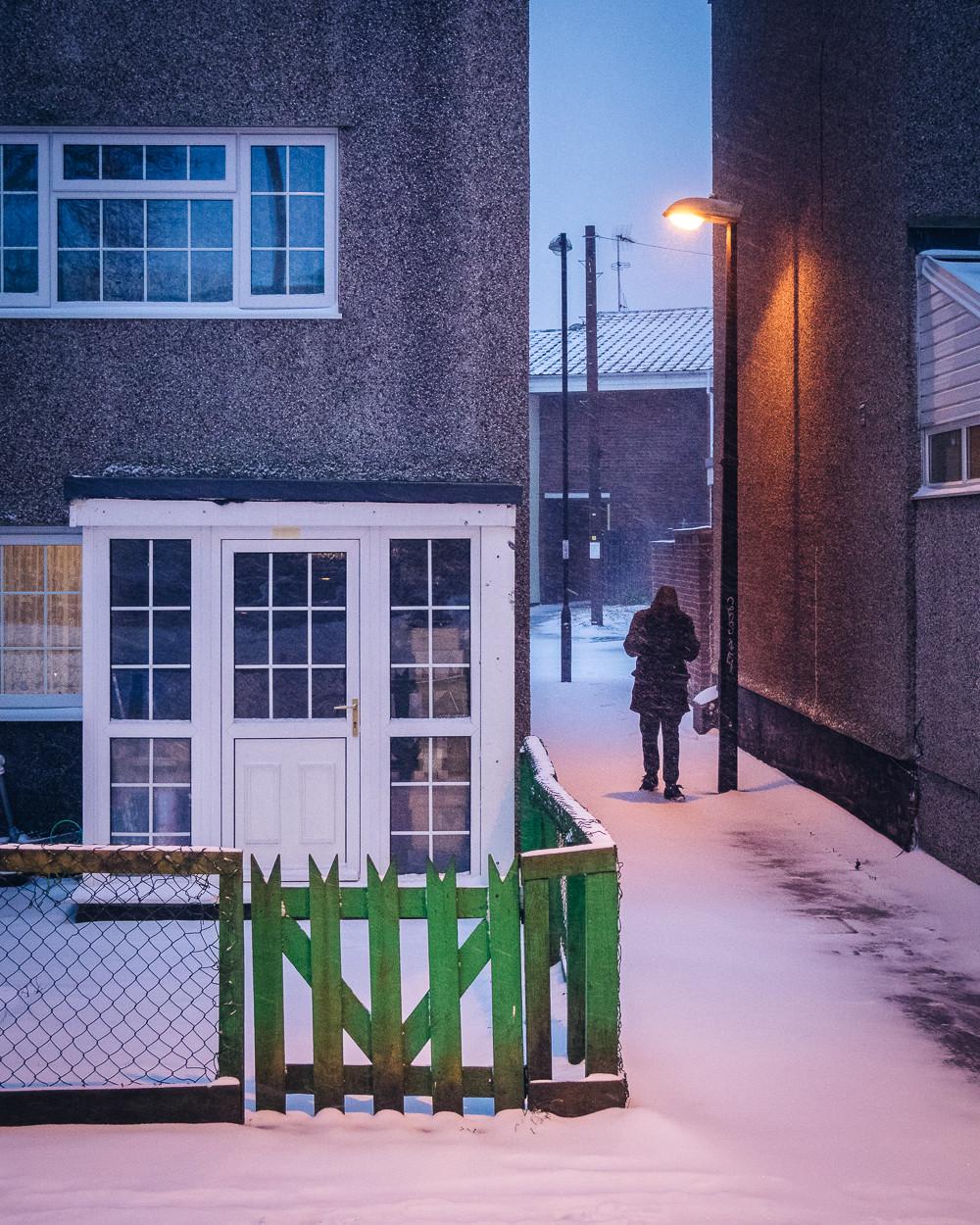 Green Gate on Snowy Night