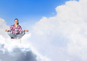 Young woman sitting on chair and meditat