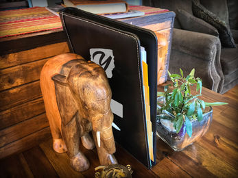 Your workbook sits handsome on any bookshelf in the den.