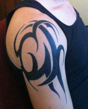 Hand-painted temporary tattoo.