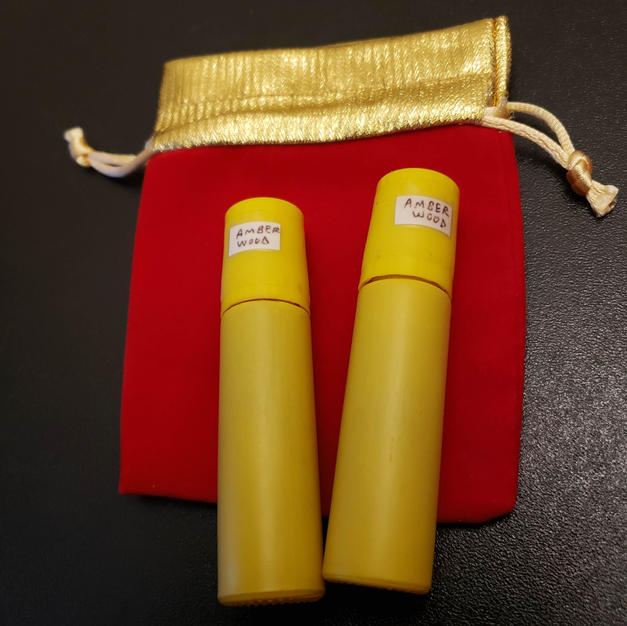 $10.00 UNISEX yellow bottle Amber Wood
