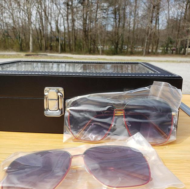 $35 red,black,green sunglasses