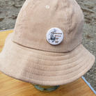 "$40 UNISEX khaki corduroy bucket hat with ""Conscious Style"" button"