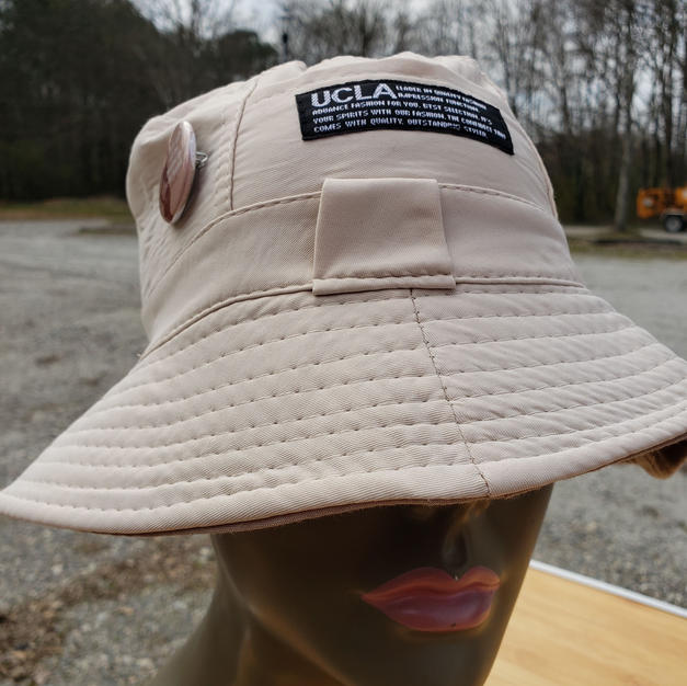 """$25 female cream fishing hat with """"Go positive"""" button"""