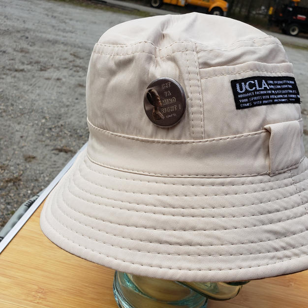 """$25 UNISEX cream fishing hat with """"Get ya mind Right"""" button"""