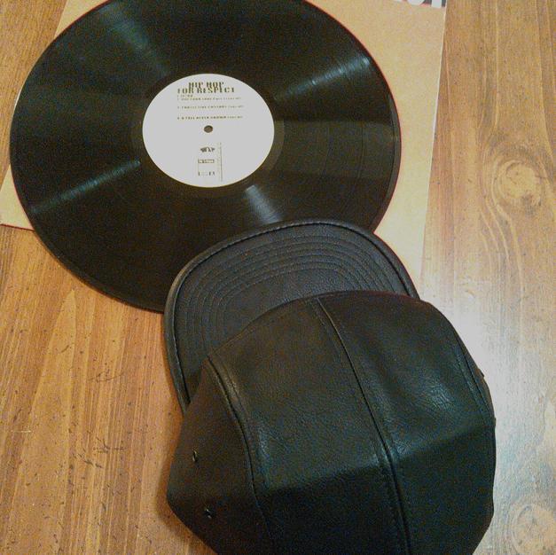 $50 UNISEX black leather 5 panel cap