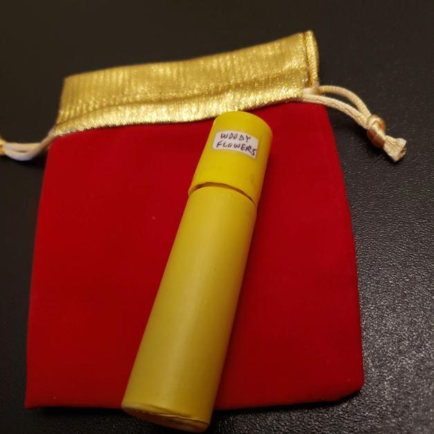 $10.00 female yellow bottle Woody Flowers