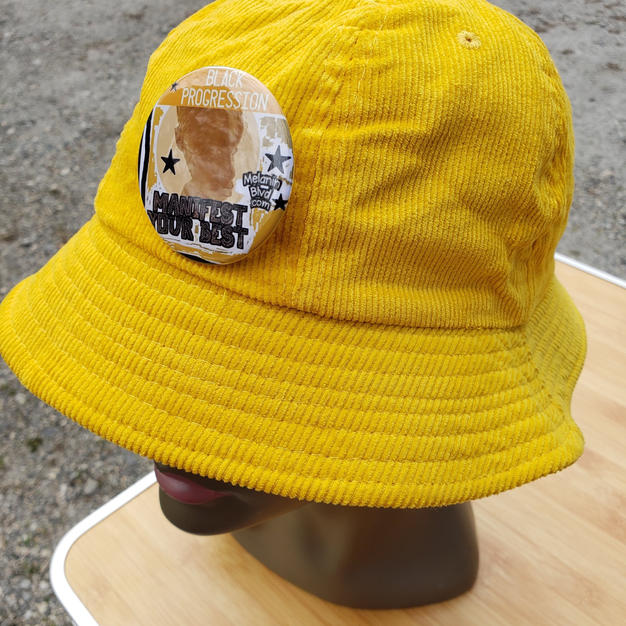 $40 UNISEX yellow corduroy bucket hat with button