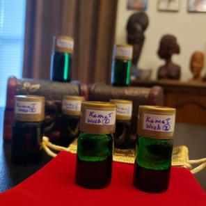$5.00 UNISEX green bottle Kemet Wood 2