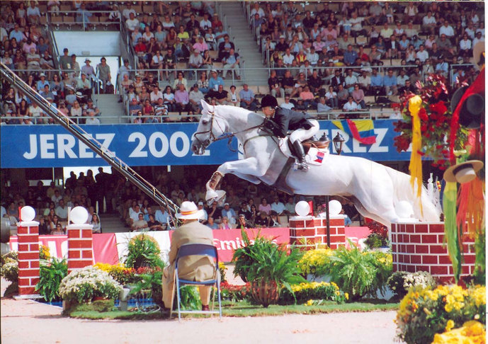 Toni with Ghandy jumping the 16-feet open water at the 2002 World Equestrian Games in Jerez, Spain.