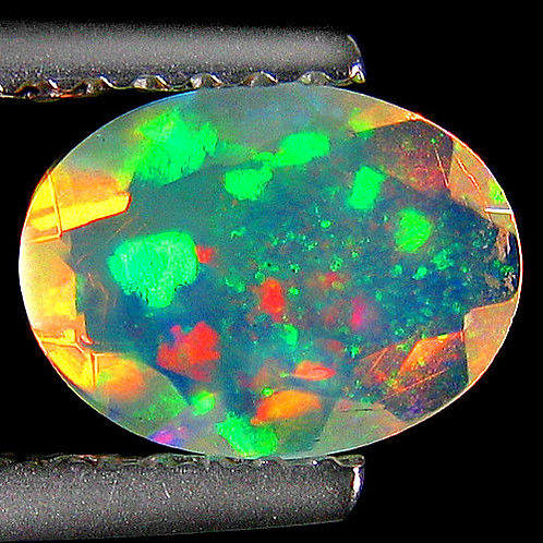 Камень RAINBOW MULTI опал натуральный 0.64 карат