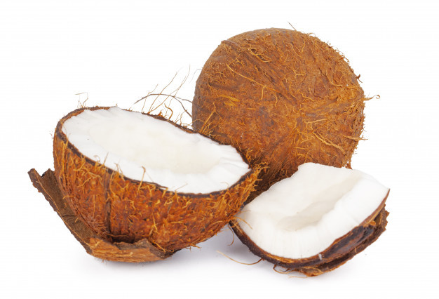 Coconut whole and split open.
