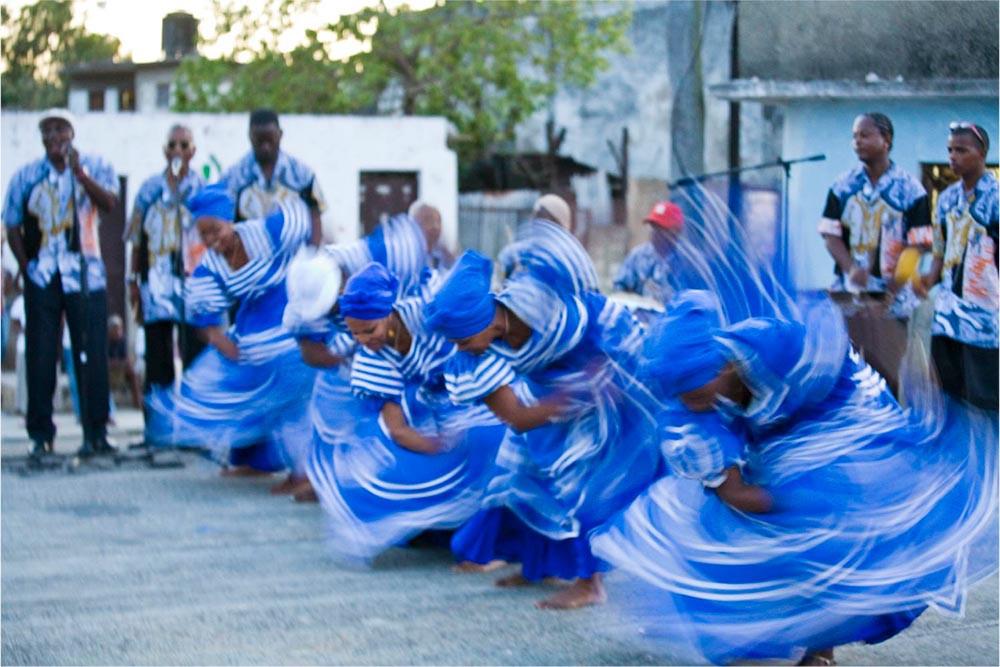 Yemayá dancers in blue dresses.