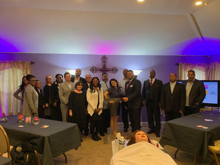 Monica poses with students from NW MS Community College and licensed Funeral Directors and Embalmers