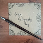 Card designed for World Calligraphy Day on 12 August. Used a Nikko G nib and a straight pen holder to write and doodle with black Sumi ink on kraft card.