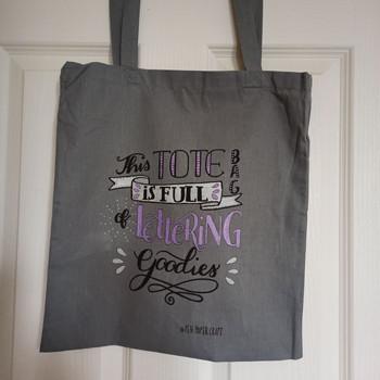 Handlettered design on a cotton tote bag