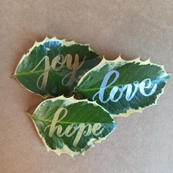 Handlettered words on leaves