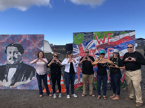 KCI employees in front of We Are Mauna Kea paintings