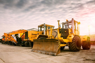 Two heavy wheeled tractor one excavator