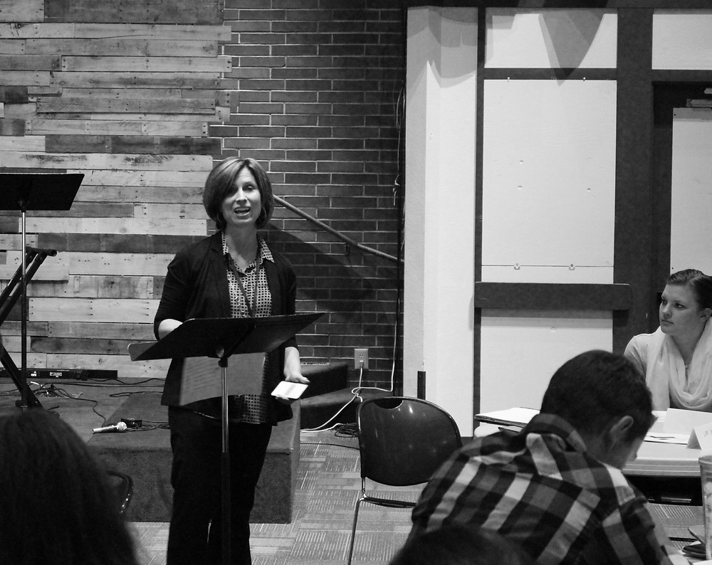 Shelley Pauls of We Love Our City welcomes those in attendance.