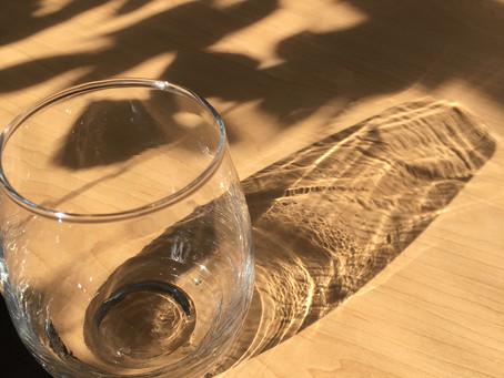 Through a glass, lightly