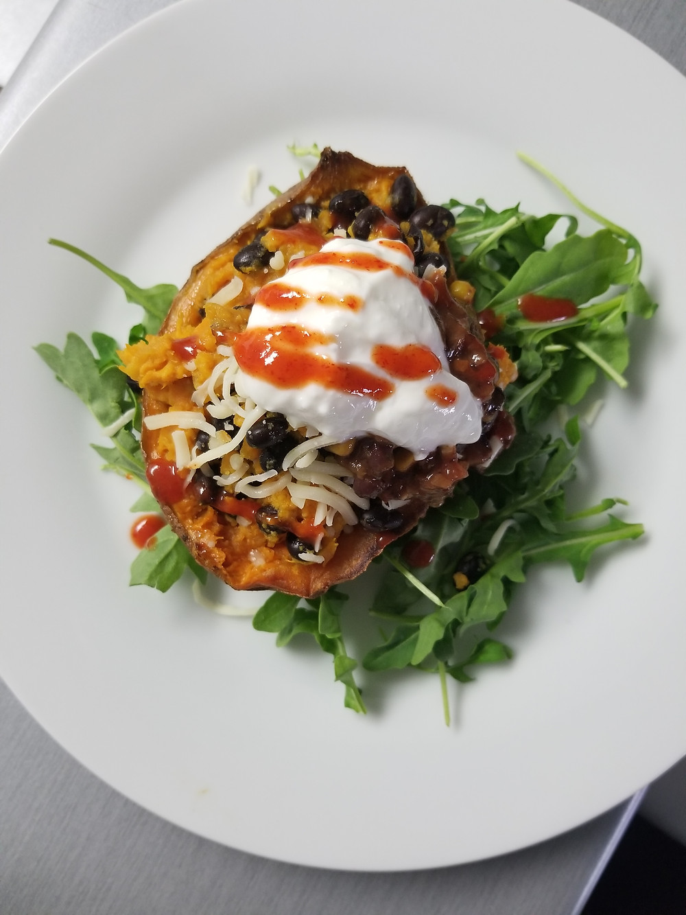 Black bean stuffed sweet potato, vegetarian entree, meatless meal, mexican