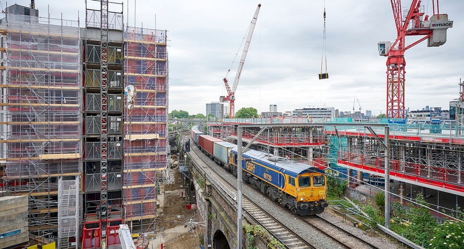 Trains continue to pass through the development, seen here on 24th May 2017