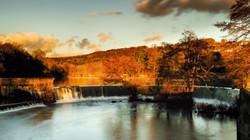 Belper Weir sunlight golw