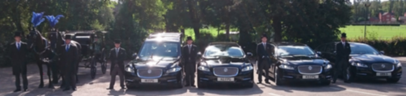 Horse Drawn Hearse and Jaguar XJ Hearse and Limousines