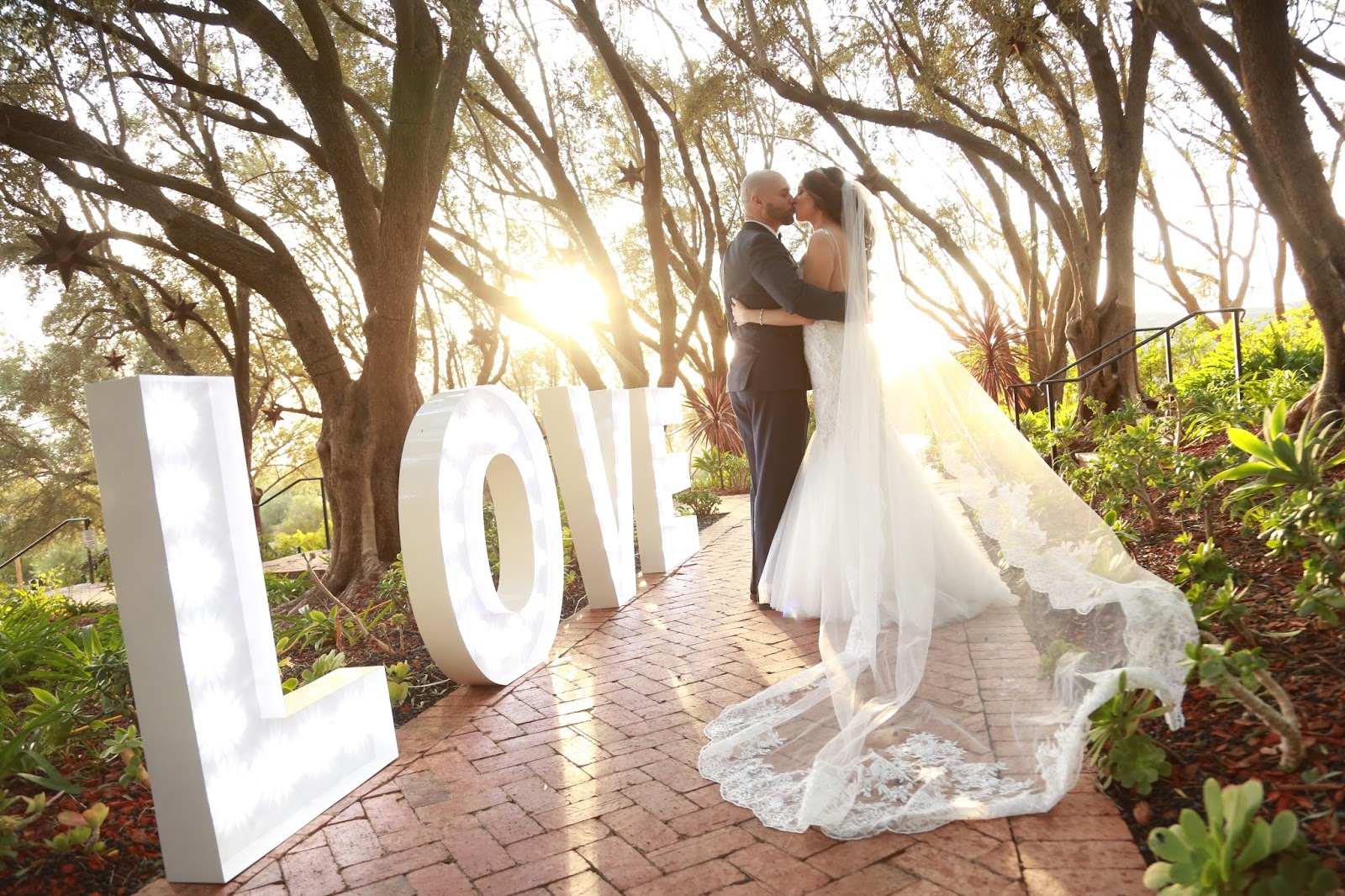 Bride and Groom by LOVE sign