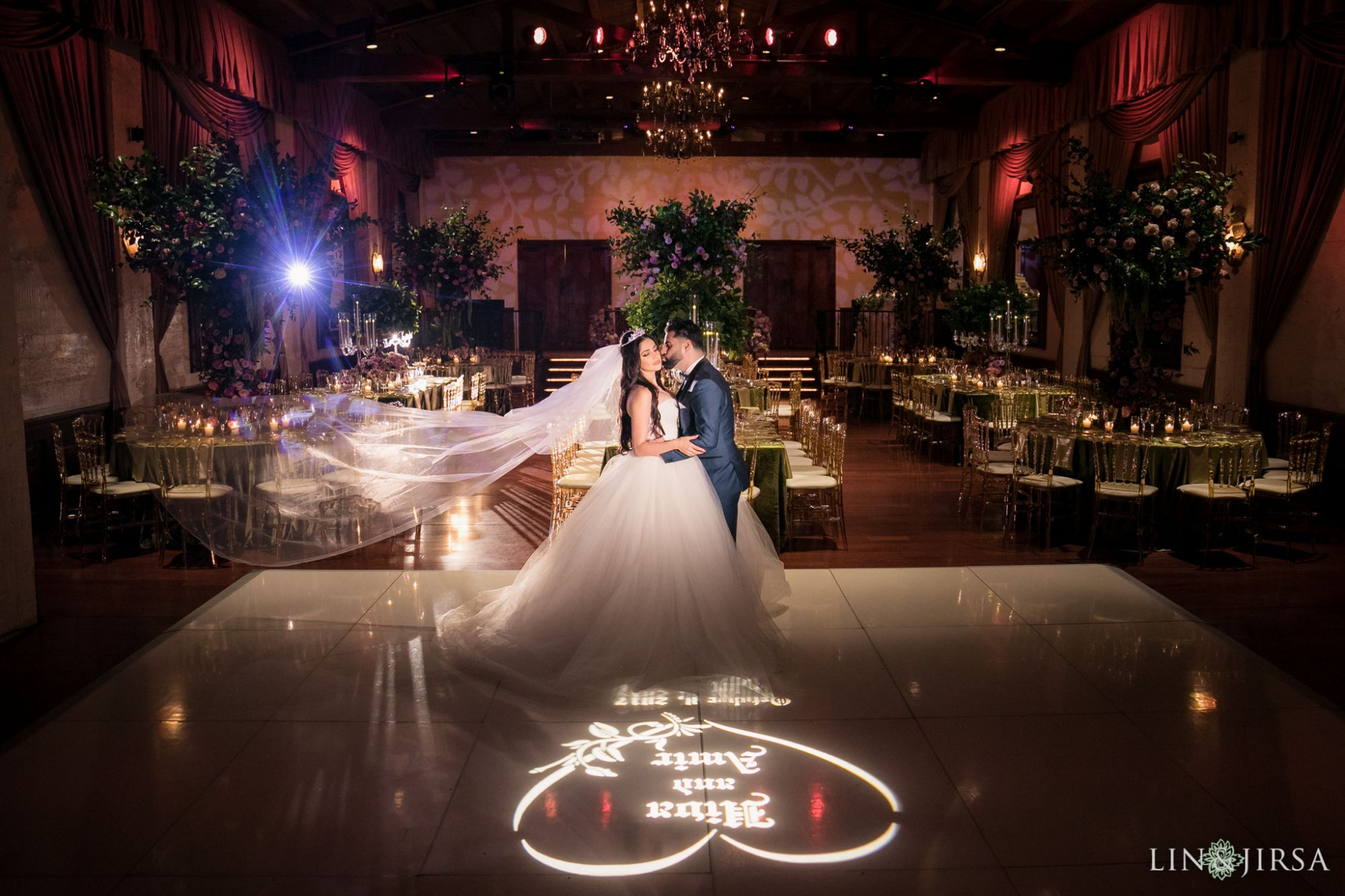 White dance floor and monogram gobo
