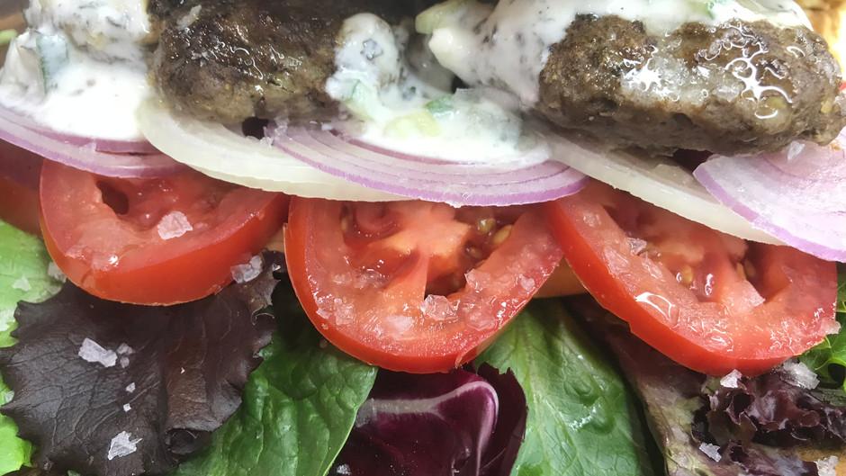 Greek Pita Sandwiches ( aka Gyro Pita ) With Creamy Yoghurt and Herb Sauce ( Tzatziki )