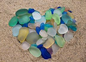 Sea Glass arranged in the shape of a Hea