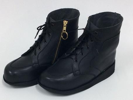 Zip up black boots
