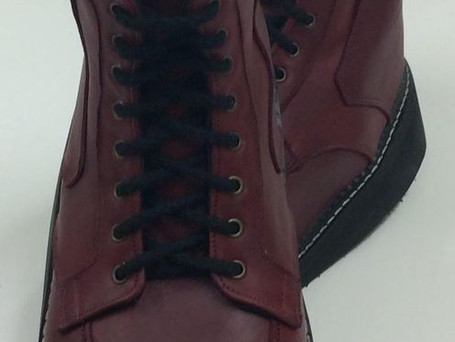 Burgundy boots with rand around sole edge