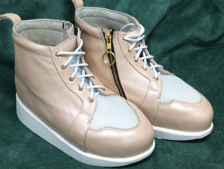 Beige and white boots with zip and lace fastenings