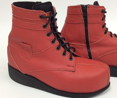 Red leather boots with leather strip embelishments around ankle